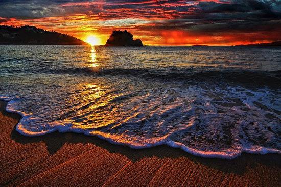 عکس زیبای غروب آفتاب در کنار دریا